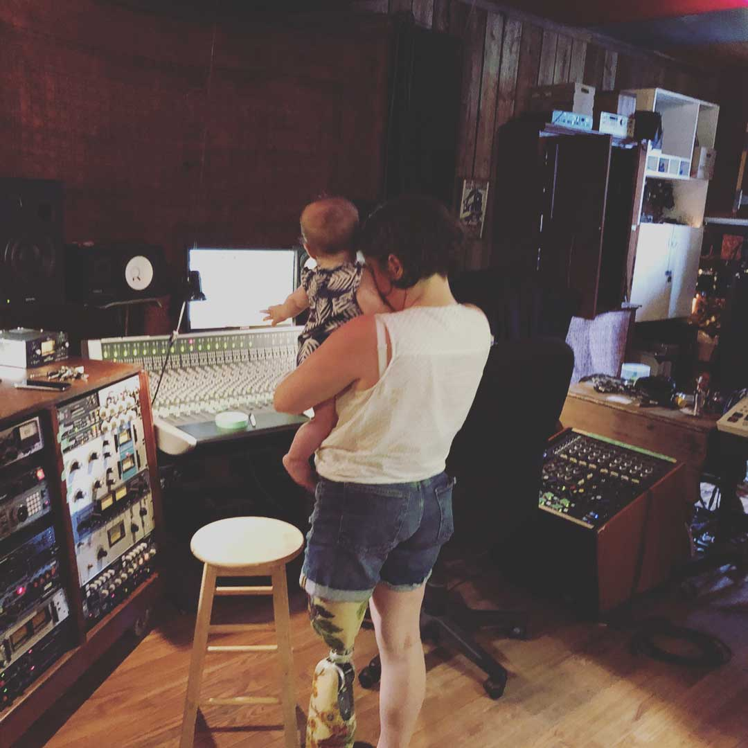 mother and baby recording a song in studio